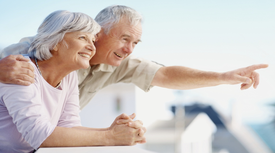 Senior man pointing out to something interesting to his wife